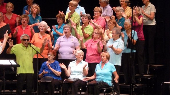 altos clapping in colored shirts